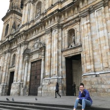 Daisy sitting on the steps of the Catedral